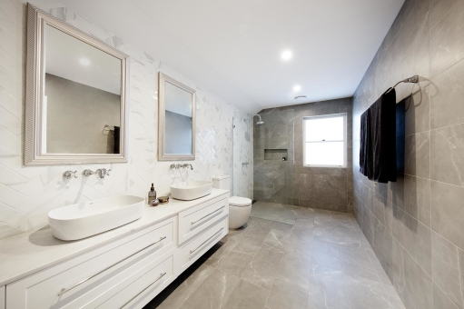 Classic-style Ensuite with subtle tones and comfortable space for two