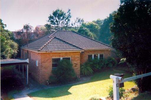 Before renovation – a modest 2 bedroom, brick bungalow on the low side of the street.